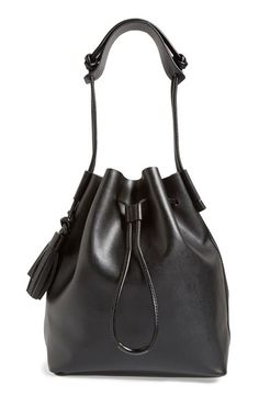 Free shipping and returns on Vince Camuto 'Lorin' Drawstring Tote at Nordstrom.com. Contrasting tassel details further the smart vintage style of a lightly structured drawstring tote shaped from impeccably smooth leather.
