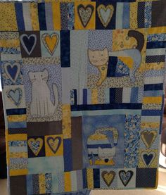 Would love to have a cat quilt!