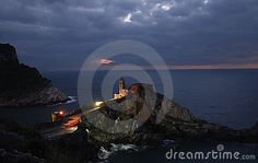 Fishing boats on a harbor with the seafront view of Portovenere in Italy.