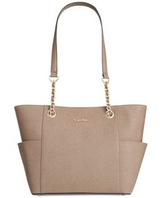 Take your look on a haute hiatus with this classic-chic tote from Calvin Klein. Rendered in soft Saffiano leather with signature detailing, it's ideal for work, weekend and anywhere in between. | Prof
