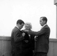 Marilyn with Milton Greene and broadcast journalist Edward R. Murrow during discussions at the Ambassador Hotel regarding Marilyn's forthcoming Person to Person interview, April 1, 1955.