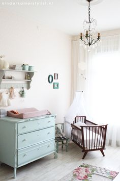 girls mint pink nursery with chandelier