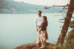 Northwest couple with cool style on cliff overlooking river @myweddingdotcom