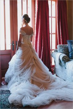 "dress is by Ian Stuart and the style name is ""Antoinette"" in honey/gold. The dress wasn't specially made, but it came with a separate tulle shawl"