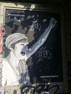 #UnCriSourd #WeAreCharlie (#ASilentScream #JeSuisCharlie) Coller par Atome à Paris 18ème arrondissement.  Collage de Atome à Montmartre, 18ème arrondissement de Paris.
