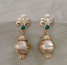 Gold Bead Earrings - Large indian beads form the focus of this pair of 18 k handcrafted gold earrings.