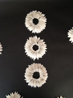 Syra Gomez Ceramics sample of select bespoke, contemporary ceramic and  porcelainwall sculpture installations, porcelain flowers and jewelry  collections.