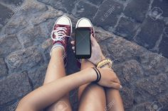 43431327-teenager-girl-sitting-with-mobile-phone-in-hand-in-ancient-stone-floor-Stock-Photo.jpg (1300×866)