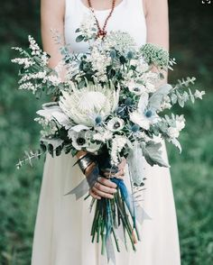 Incredible Wedding Bouquet Featuring: Blue Eryngium Thistle, King Protea, White Anemones, Several Varieties Of Eucalyptus, Greenery & Foliage Anemone Indie Indigo Wedding Ideas Inspired by Bonnaroo - Green Wedding Shoes Protea Wedding, Blue Wedding Flowers, Floral Wedding, Wedding Colors, Wedding Ideas, White Flowers, Wedding Blue, Blue Wedding Bouquets, White Anemone Flower