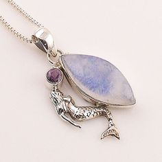 """Moonstone set in solid sterling silver artisan crafted pendant. DETAILS: * Moonstone Pendant * 3.9 g total weight * Set in SOLID .925 Sterling Silver * Measures approximately 1"""" x 1 1/2"""" long includin"""