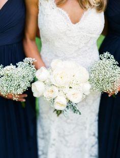 White ranunculus and baby's breath: http://www.stylemepretty.com/new-york-weddings/saratoga-springs/2015/10/12/elegant-saratoga-springs-summer-wedding/   Photography: Lindsay Madden - http://lindsaymaddenphotography.com/