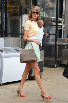 Don't get us wrong, Taylor has always loved a bold, red lip, but her overall pastel-meets-neutral color scheme is what we're really attracted to this time around. With the help of that embellished barrette and those cat-eye sunglasses, she's definitely got her sartorial sophistication on lockdown. Scroll down to pull off your own signature Swift ensemble. Source: Getty / NCP/Star Max