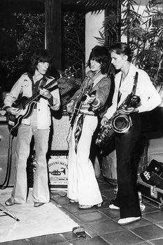 Bill Wyman and Ronnie Wood with David Bowie on sax.