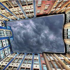 Sky between tall buildings
