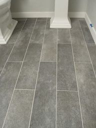 S Wide plank tile for bathroom. Great grey color!    would love for all bathrooms.