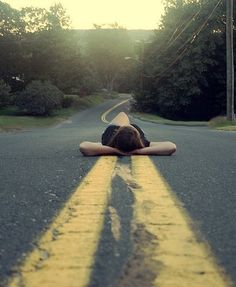 Senior photography. Senior girl photos. Pics. Poses. Street. Highway. Lying down.