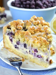 Blueberry Cheesecake Crumb Cake is delicious combo of two mouthwatering desserts: crumb cake and blueberry cheesecake. With this simple and easy dessert recipe you'll get two cakes packed in one amazing treat. Creamy and smooth cheesecake is bursting with blueberries!