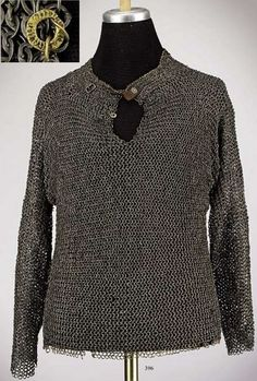 """European (German, Nuremberg) riveted mail hauberk, end of the 15th century, long sleeves of flattened riveted rings, collar and seams are bordered with two rows of brass rings, original buckle with leather remnants is riveted to the collar, brass armourer's ring at the neck stamped with the maker's inscription, """"Hans M..."""" in front of two stylised towers. Length 67 cm. Weight 14lbs. Late Gothic mail shirt in unusually fine condition. F1."""