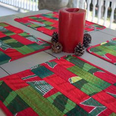 """Create a bold, contemporary Christmas tablescape with this set of four Marimekko placemats. Four different Marimekko fabrics are cut and sewn into beautiful patchwork rows and then quilted with wavy stitches to add texture and design. The side-by-side colors are vibrant and each placemat is unique. Marimekko """"Irmeli"""" is used for the backing and binding fabric – the placemats are reversible so you can mix and match the two sides"""