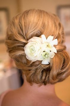 White dendrobium and white ranunculus floral hair arrangement. Photograph by Jon Koch Photography. ~ Cosmopolitan Events