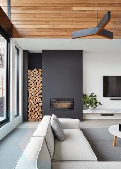 Want to get a perfect living room wall color? Try one of these latest living room wall colors Here you can find some of the living room wall color schemes Scandinavian Fireplace, Modern Fireplace, Fireplace Design, Decorative Fireplace Logs, Inset Fireplace, Bloomfield Homes, Chimney Decor, Room Wall Colors, Interior Architecture