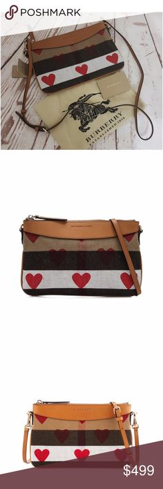 "NWT Burberry Canvas Check Hearts Peyton Wristlet ***100% GUARANTEED AUTHENTIC OR YOUR MONEY BACK!***  Burberry heart-print check canvas crossbody bag with leather trim. Golden hardware. Removable, adjustable shoulder strap, 20"" drop. Zip top closure. Embossed logo at top center. Logo jacquard lining; four card slots. 7""H x 10""W  Burberry dust bag and authenticity manual included Burberry Bags Clutches & Wristlets"