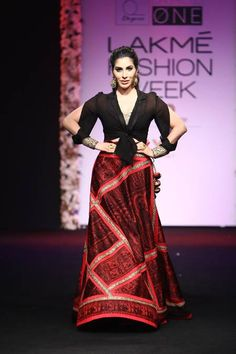 Sophie's Bringing Sexy Back.. #SophieChaudhary is one rock star, and in this Sumona Parekh outfit that she modeled on the runway at the LFW, she looks like she's trying to bring back the golden era when long Indian printed skirts were a thing. The cold-shouldered top in black in a great way to merge current trends with retro chicness!.. Buy the look at https://www.estrolo.com/whatstrending/sophies-bringing-sexy-back/