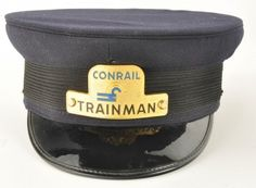 """Railroad Trainman's Cap for Conrail with enameled hat badge. Tag inside reads """"Head-Master Patented and Manufactured by Wentworth Forman Boston Mass"""". size: unmarked"""