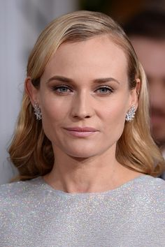 Keep things simple like Diane Kruger with her minimal - yet wavy - side parting and her pretty make-up. Pearly pink lips and pale metallic eye make-up finished with mascara are perfect for the city chic bride!