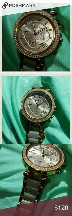 Beautiful MK. watch Bought for myself for bday locally 2 weeks ago. My hubby got one too so I can't wear em both. Diamond trim.. really pretty.. Michael Kors Accessories Watches
