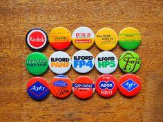 15 magnets of film types and makers of fine film.  Kodak, Fuji, Ilford, Agfa, Adox, Minox, Gevaert.
