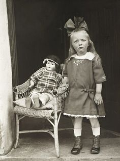 Girl with her Doll in a Chair, about 1927-30