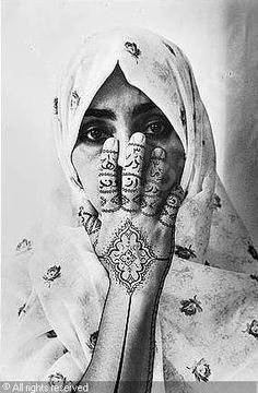 Birthmark (women of allah series) sold by Sotheby's, London, on Thursday, February 08, 2001  I enjoy the work of Sharin Neshat as she is able to convey a bredth of emotions, history, and strength of Muslim women using minimal expression and body language.