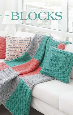 Geometric Pillows & Afghans - In Geometric Pillows and Afghans from Leisure Arts, simple shapes and dynamic colors make five pillow and afghan sets pop as home accessories! Designs by Melissa Leapman include Stripes, Diagonals, Dots, Blocks, and Squares, all created with only basic crochet stitches. Each uses Easy skill level and medium, bulky, or super bulky weight yarn. All the patterns feature large square blocks, with each pillow using two blocks and each afghan using 12 blocks.
