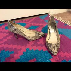 """Michael Kors Flex Embossed-Leather Pump """"Snake pattern-embossed leather and a ladylike mid-heel render our classic Flex pumps exotic and elegant, while a subtle gilded plaque at the back provides a signature touch."""" Womens size 9.5. Used but in almost perfect condition. Very rarely won. MICHAEL Michael Kors Shoes Heels"""