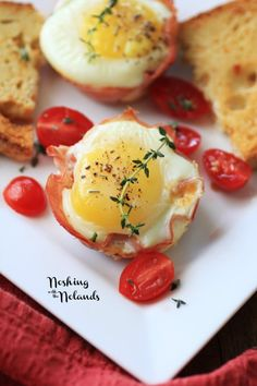 Ham and Egg Cups by Noshing With The Nolands - A delicious twist on a traditional ham and egg breakfast, with sun-dried tomatoes, cheddar cheese, and spinach.