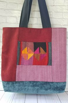A unique handmade boho tote bag designed around a Peruvian tapestry. Strong, bold colors make this a spring and summer must-have!