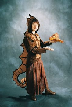 Nice seahorse look. We'd need two seahorse costumes. This does look a bit difficult/expensive, though. The Little Mermaid Musical, Little Mermaid Play, Little Mermaid Costumes, Horse Costumes, Animal Costumes, Diy Costumes, Costume Ideas, Seahorse Costume, Fish Costume