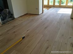 Engineered English Oak Flooring installation - beautiful long & wide floor boards,laid in the traditional fashion of using mixed-width boards.