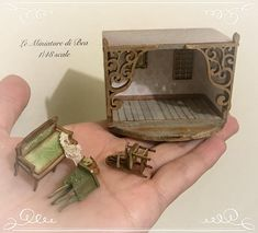 1/48 victorian roombox with furniture and accessories living room scene hand made in wood by Bea dollshouse miniatures. The furniture and accessories are not glued, only the picture frames are glued.