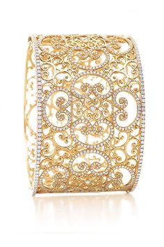 Paloma's Venezia Goldoni cuff in 18k gold with diamonds. Tiffany's
