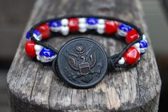 Patriotic Red, White & Blue Wrapped Leather Bracelet with Red Coral and Vintage Military Uniform Button. $25.00, via Etsy.