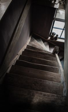 The view looking down the rear stairs leading to the maid's attic bedroom of a mansion built in 1846.