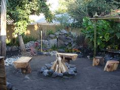 """Landscape Makeovers From Turf War: The once weedy backyard is transformed into a themed """"pirate's cove"""" with rustic seating, fire pit and outdoor bar. Retaining walls constructed from feather rock and multi-level plantings add dimension to the enclosed space.  From DIYnetwork.com"""