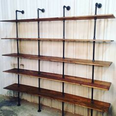 """Industrial Furniture looks great in any space, especially this modern industrial shelf unit. Each shelf is custom joined to achieve a 16"""" depth for this unit. Pipe bookshelves can also be custom designed for your space. This industrial shelving unit maintains a modern shelving look with the black pipe accentuating the custom stained shelving. This pipe shelving will arrive partial assembled via freight carrier and most customers can assemble easily, You will have a very beautiful industr..."""