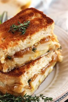The BEST Grilled Cheese Sandwich you'll ever make! This Caramelized Onion Pear Grilled Cheese Sandwich has all the flavors of French onion soup without the soup part.with a hint of sweetness form juicy pears. Simple, sweet and savory all at once. Best Grilled Cheese, Grilled Cheese Recipes, Sandwich Recipes, Gormet Grilled Cheese, Grilled Cheese Sandwiches, Mini Grilled Cheeses, Gourmet Sandwiches, Panini Sandwiches, Grilled Sandwich