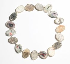 Dania Chelminsky Necklace: Printed string 1, 2010 Epoxy, silver, photos, eggshells, threads, plant roots ø 17 x 0,6 cm