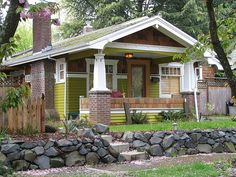 Craftsman house with moss green paint.