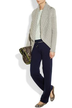 Juicy Couture's soft cashmere track pants will add a touch of luxury to your off-duty routine. The relaxed fit is perfect for staying comfortable on long flights - style it with a draped cardigan and cool snake-effect accents.   Shown here with: Helmut Lang sweater, T by Alexander Wang top, Alex Monroe ring, Lanvin shoes, Stella McCartney bag.