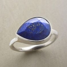 IN DEPTH RING--Deep in both coloration and dimension, lapis lazuli sits sideways on its slender, hammered band. Handmade exclusive in brushed sterling silver. Whole and half sizes 5 to 9.
